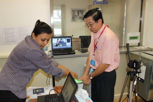 Sychanh Panyasavath during the recording of his digital fingerprints